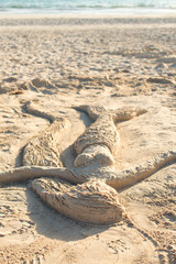 Mermaid made of sand on the beach.