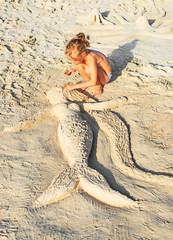 Mermaid made of sand on the beach.