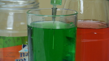 laboratory flask with green liquid.