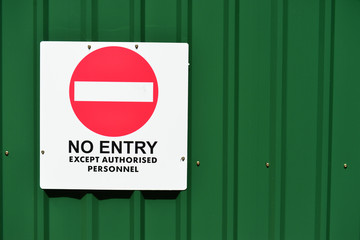 No Entry Sign On  A Green Corrugated Sheets Fencing