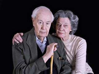 Marriage elderly, on a black background