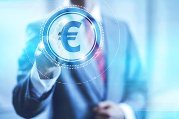 Businessman pointing towards camera selecting euro symbol