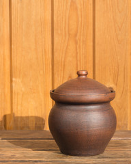 Clay pot on wooden boards