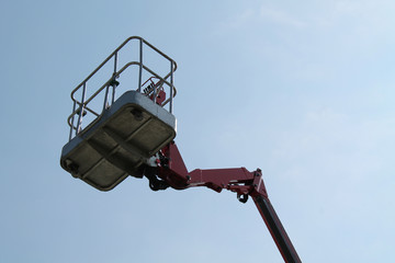 The Cage at The Top of an Hydraulic Cherry Picker Lift.