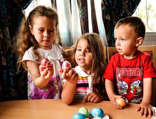 Children traditionally beat Easter eggs.