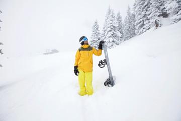 Snowboarder planning descent