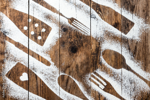 Papiers peints Table preparee Cutlery old wooden table sprinkled with flour.