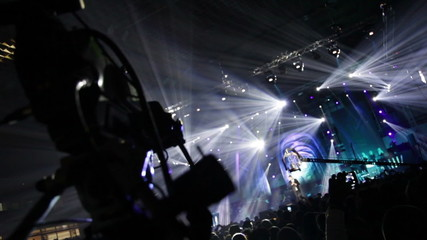 Television production on the set of a large rock concert