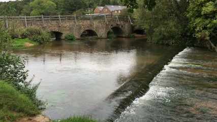 Weir on English village river