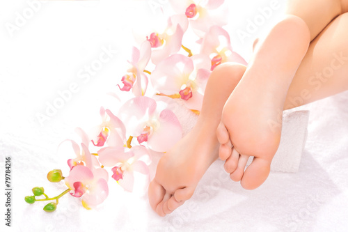 Foot massage in the spa salon - 79784216