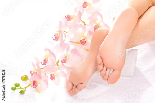 Foot massage in the spa salon - 79784216