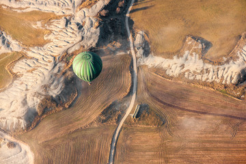 Air baloon landing over grow fields