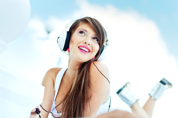 young beautiful woman are listening music