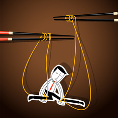 Businessman marionette on noodle controlled by chopsticks