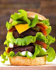 Big burger with beef cutlet and fresh vegetables