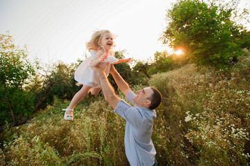 Healthy Father and Daughter Playing Together at Sunset.