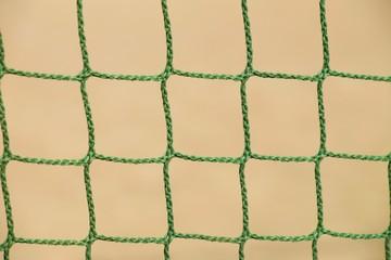 Detail of crossed soccer nets, soccer football in goal net