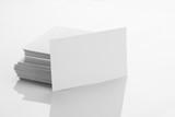 Blank Business Card Mockup on White Reflective Background