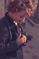 Vintage redhead women with camera in her hands