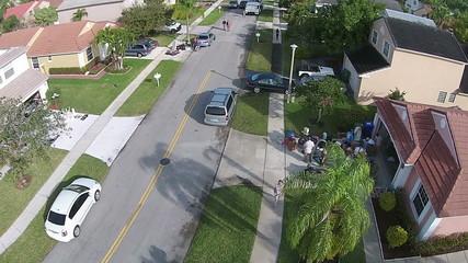 Neighborhood garage sale aerial view