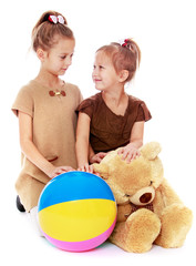 two charming sisters with a ball