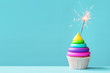 Colorful cupcake with sparkler - 79789004