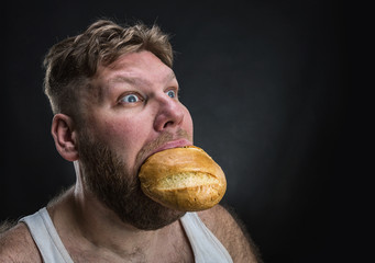 Man eating a big bread