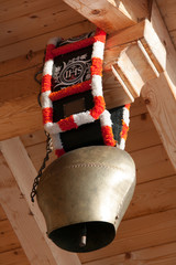 Cow bell hanging under the roof of a hut