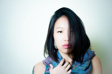 Young asian woman close up posing looking at camera