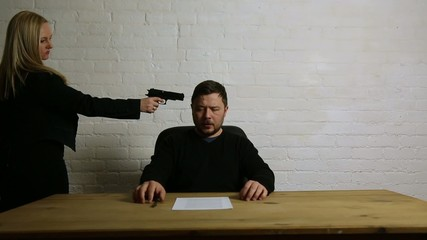 man signs contract at gun point of woman