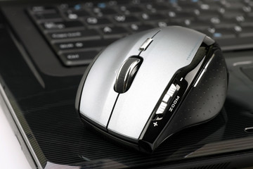 wireless mouse on a laptop on a white background