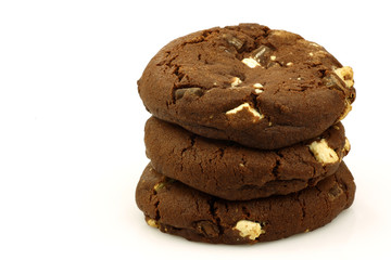 chocolate chip cookies with nuts on a white background