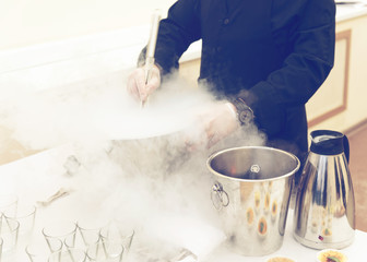 Chef is cooking ice cream with liquid nitrogen