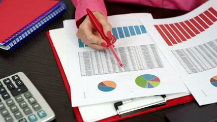 woman considering financial report and scheme