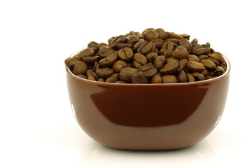a brown bowl filled with coffee beans