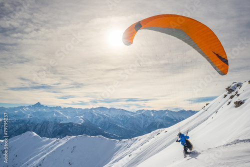 Leinwandbild Motiv Paraglider launching from snowy slope