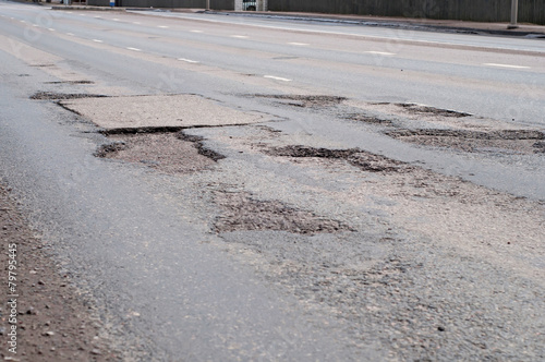 Big hole in street asphalt - 79795445