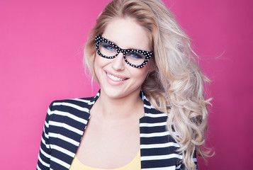 Young attractive happy woman wearing glasses