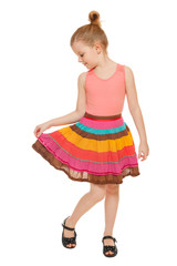 Little happy girl full lenght in colorful skirt, isolated