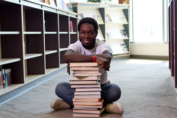 African man sitting on floor at library