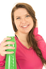 Cheerful young female model holding a green water bottle