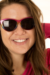 Close-up portrait of a young female model wearing sunglasses