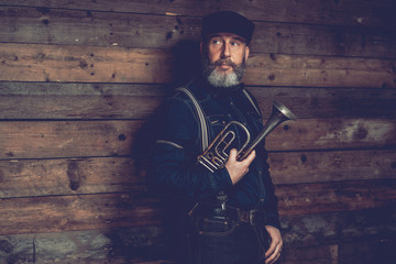 Serious Middle Age Man in Black with Trumpet