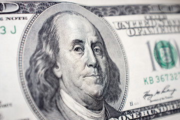The close-up of Benjamin Franklin's face on the 100 dollar bill