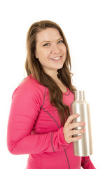 Sideview of a woman holding a stainless steel water bottle