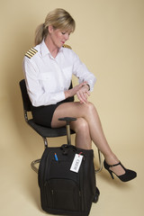 Attractive airline pilot checking the time before going on shift