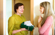 mother with gift  congratulating daughter