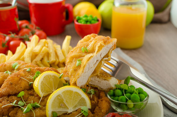Schnitzel, french fries and microgreens salad