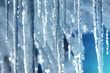 Background of bright transparent icicles in the sunlight - 79800070