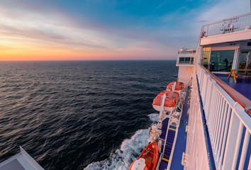 Cargo passenger ferry at sunset